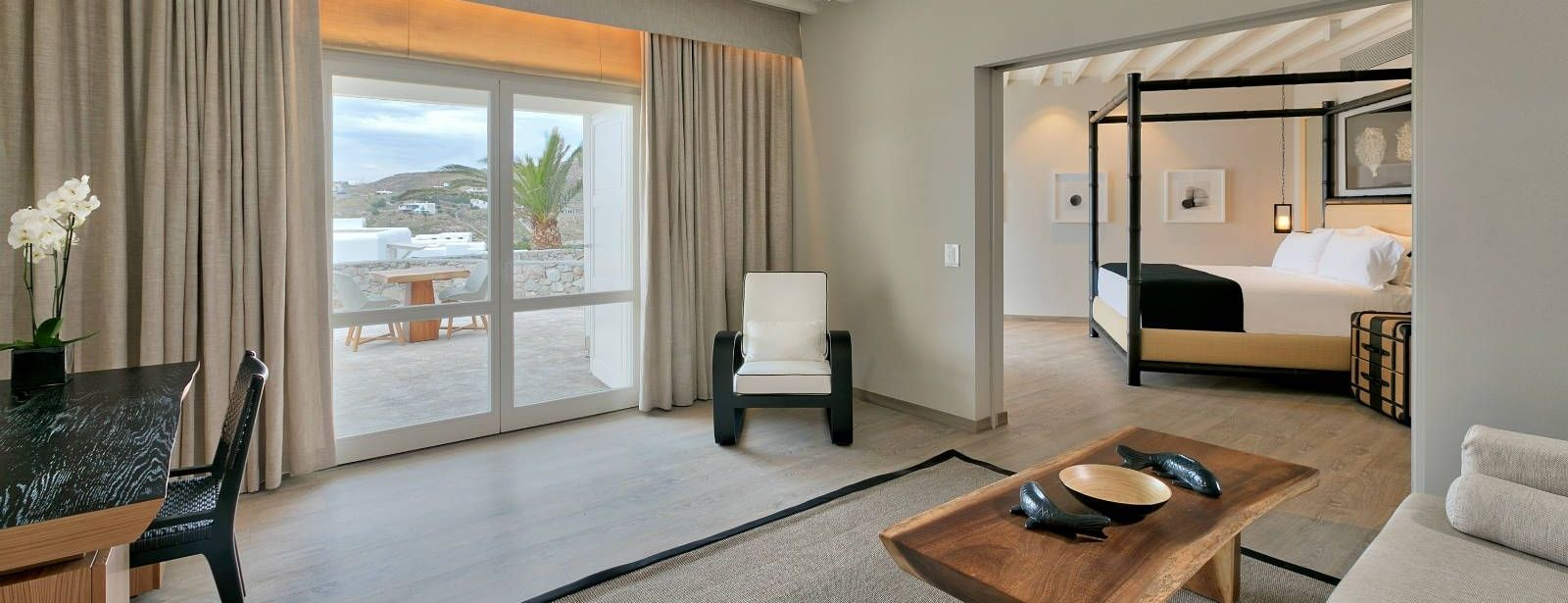 Deluxe Seaview Suite living room and bedroom at Santa Marina Resort Mykonos Luxury Hotel
