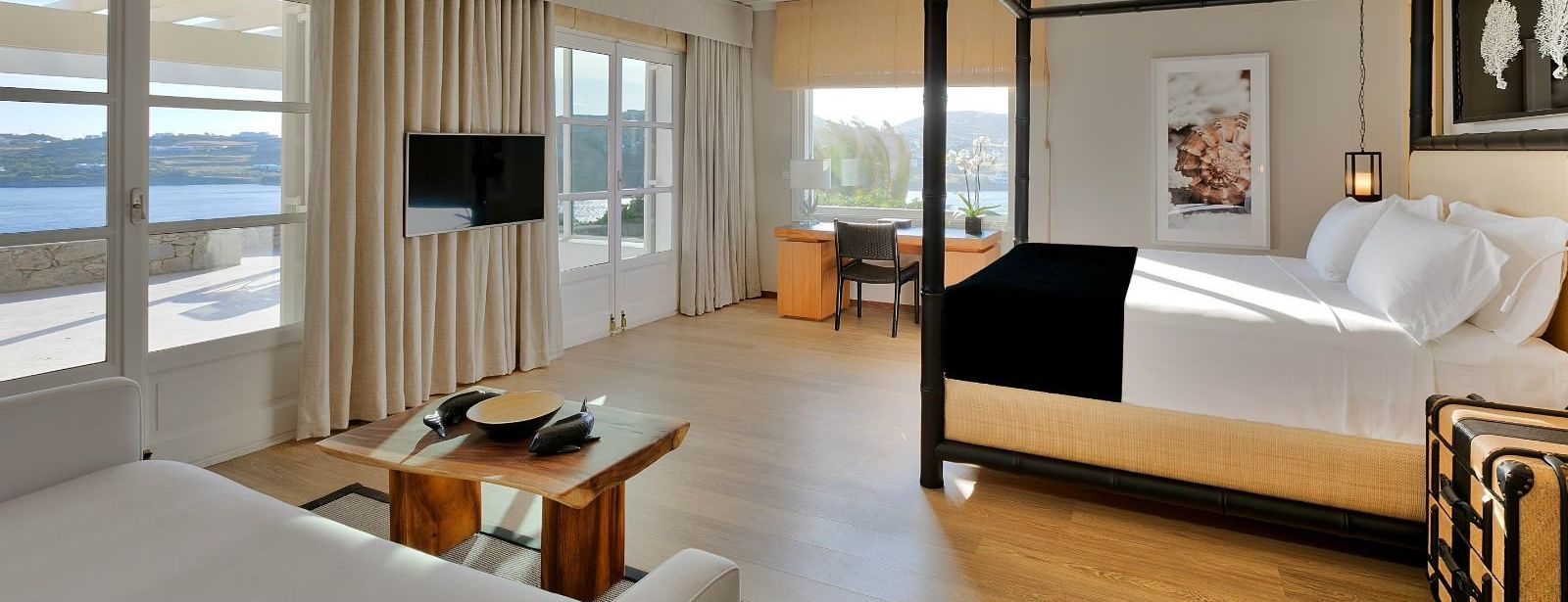 Seaview Suite bedroom with private balcony at Santa Marina Resort Mykonos Luxury Hotel_191